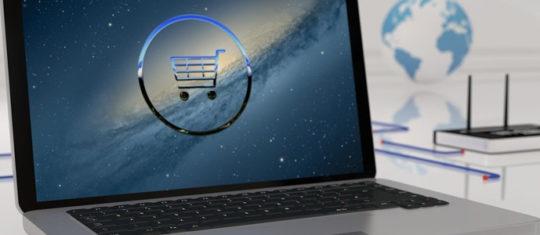 Un ordinateur avec un logo ecommerce en fond d'écran
